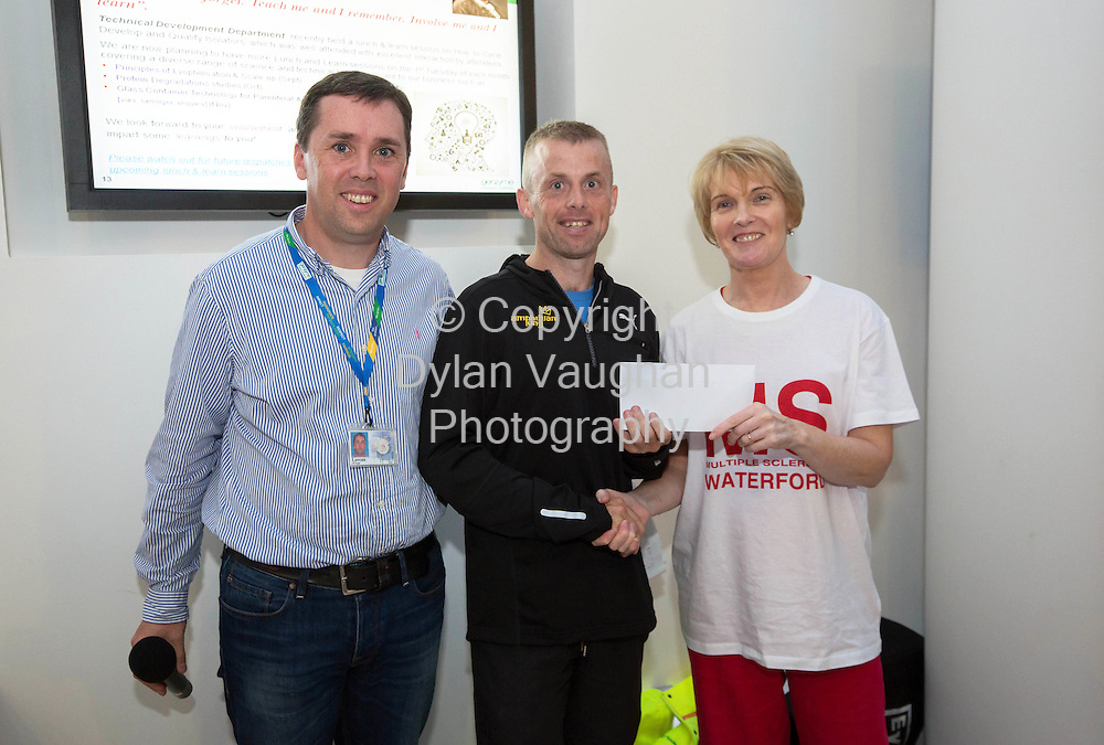 Repro free no charge for repro<br /> <br /> 29/8/14<br /> <br /> <br /> Overall male race winner Philip Hartley with a time of 25:30 pictured with Lorcan O'Toole Genzyme (left) and Eileen Nolan of the Multiple Sclerosis Society of Ireland (right) as almost 400 runners and walkers took part in the 4th annual Genzyme Five Miles for MS Road Race. All funds raised from the event go to the local branch of the Multiple Sclerosis Society of Ireland.<br /> Picture Dylan Vaughan