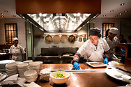 """A woman cook at """"dumpling station"""" in China Live market restaurant in Chinatown, San Francisco."""