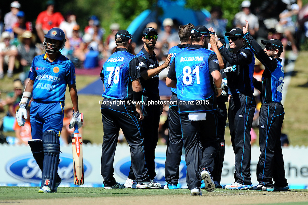 Black Cap players celebrate the wicket of Dimuth Karunaratne during Match 4 of the ANZ One Day International Cricket Series between New Zealand Black Caps and Sri Lanka at Saxton Oval, Nelson, New Zealand. Tuesday 20 January 2015. Copyright Photo: Chris Symes/www.Photosport.co.nz