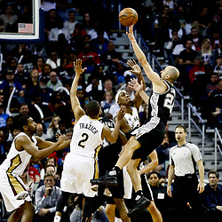 Mar 3, 2017; New Orleans, LA, USA; San Antonio Spurs guard Manu Ginobili (20) is fouled as he shoots by New Orleans Pelicans guard Tim Frazier (2) during the second quarter of a game at the Smoothie King Center. Mandatory Credit: Derick E. Hingle-USA TODAY Sports