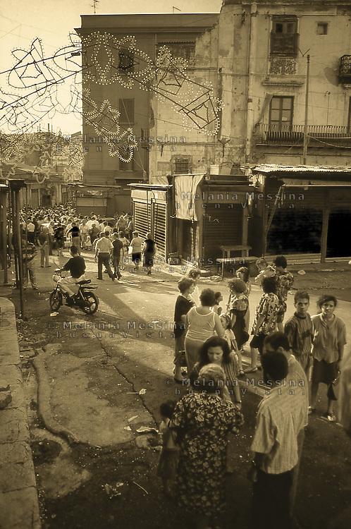 Palermo; religious feast and procession in Ballaro' market.<br /> Palermo, processione per la festa religiosa nel quartiere del mercato di Ballaro'.