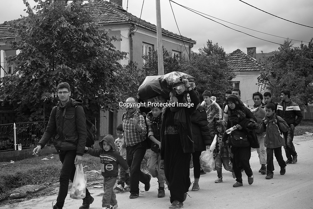 Immigrants and or refugees arriving from Macedonia to Presevo, Serbia. They are going to register with with the Serbian outhorities and then take the bus to the border with Croatia.