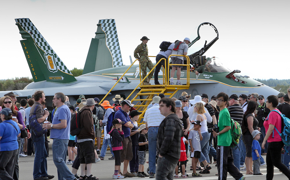 The public look in the cockpit of a RAAF F18 in the 75th Anniversary Airshow at Ohakea Airforce base, New Zealand, Saturday, 31 March, 2012. Credit:SNPA / John Cowpland