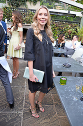SOPHIE CAULCUTT at a party to celebrate 'A Year In The Garden' celebrating the first year of The Ivy Chelsea Garden, 197 King's Road, London on 16th May 2016.