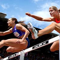 Oostenrijk, Gotzis, 30-05-2015<br /> Atletiek, Zevenkamp, Hepathlon.<br /> 100 meter horde.<br /> Dafne Schippers ( rechts, NL )  en Jessica Ennis-Hill ( GBR ) op de 100 meter horden.