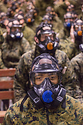 US Marine recruits are trained in proper use of their gas mask during bootcamp January 13, 2014 in Parris Island, SC.
