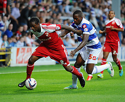 Swindon Town's Nile Ranger battle with Queen Park Rangers' Nedum Onuoha  - Photo mandatory by-line: Seb Daly/JMP - Tel: Mobile: 07966 386802 27/08/2013 - SPORT - FOOTBALL - Loftus Road - London - Queens Park Rangers V Swindon Town -  Capital One Cup - Round 2