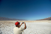 Charlie Collins of New Hampshire stops to photograph the salt flats in Badwater Basin in Death Valley National Park, Calif., on Oct. 24, 2012. At an elevation of 282 ft. below sea level, Badwater Basin is the lowest point in the U.S.