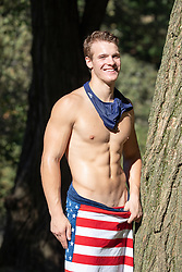 hot guy in a towel with a speedo around his neck