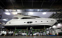 © Licensed to London News Pictures. 22/12/2012. London, UK. A Sunseeker 80 Yacht is prepared by workers inside the Excel Centre ahead of the Tullett Prebon London Boat Show in London today (22/12/12). The show runs from 12th to the 20th of January 2013. Photo credit: Matt Cetti-Roberts/LNP