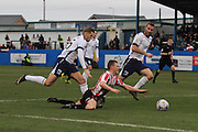 Nick Wilmer-Anderton brings down George McLennan for a penalty during the Vanarama National League match between Barrow and Cheltenham Town at Holker Street, Barrow, United Kingdom on 6 February 2016. Photo by Antony Thompson.