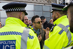 """A man remonstrates with police after they led him away from a backstage area at the Parliament Square rally after shouting """"Anna Soubry is a traitor"""", as tens of thousands of people from across the UK march from Park Lane to Parliament demanding a People's Vote on the EU withdrawal agreement before the UK leaves the EU. London, March 23 2019"""