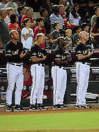 Sep. 24 2011; Phoenix, AZ, USA; Arizona Diamondbacks manager Kirk Gibson (left) , bench coach Alan Trammell , first base coach Eric Young and third base coach Matt Williams  stand during the National Anthem prior to the first inning against the San Francisco Giants at Chase Field. Mandatory Credit: Jennifer Stewart-US PRESSWIRE.