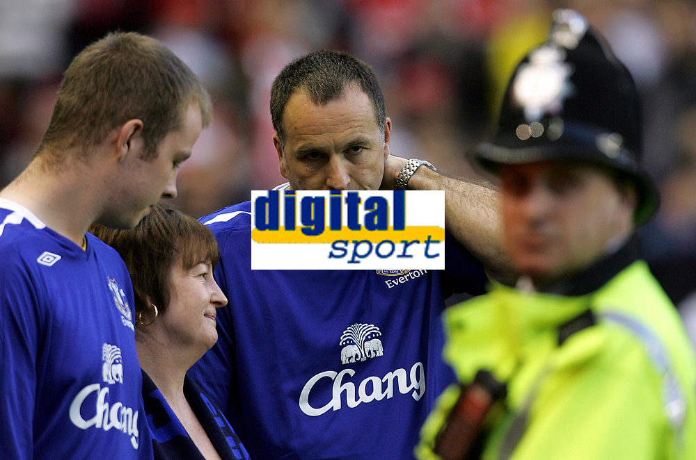 Photo: Paul Thomas.<br /> Liverpool v Toulouse. UEFA Champions League Qualifying. 28/08/2007.<br /> <br /> The family of murdered boy Rhys Jones (L-R) Brother Owen, Mother Melaine and Father Stephen, attend the Liverpool match tonight in memory of their son and brother.