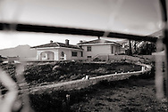 ITALY, Fondi: Claudio Fazzone's villa is seen trough a gate. The villa is confiscated  due to suspected irregularities in its construction..©Christian Minelli