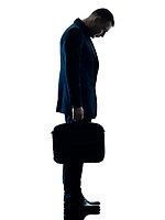 one caucasian business man standing sadness silhouette isolated on white background