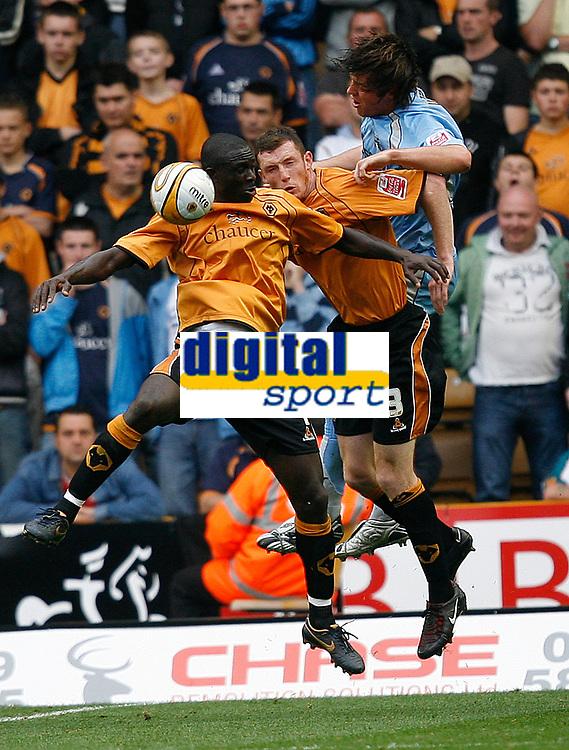 Photo: Steve Bond.<br />Wolverhampton Wanderers v Coventry City. Coca Cola Championship. 06/10/2007. Seyi Olofinjana (L) and Neill Collins (C) defend a high ball