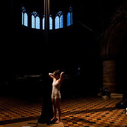 London, UK - 24 June 2013: Billie Wilson-Caffey prepares for the Tissu act during the rehearsals of ?Circa and I Fagiolini - How Like and Angel? at St Bartholomew the Great church in East London as part of the Beyond Barbican summer programme.  .