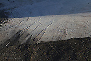 Morainal debris frames glacier in Smeerenburgfjorden on the north coast of Spitsbergen island; Svalbard, Norway.
