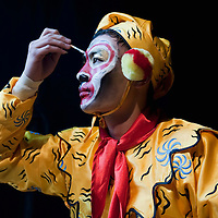 """LONDON, ENGLAND - DECEMBER 16: Yu Yan Fey of the Chinese State Circus puts make up on for  his Monkey King character for a photocall on December 16, 2009 in London, England. The Chinese State Circus today unveiled their new acrobatic spectacular  """"Mulan""""  featuring the Shaolin Warriors .  (Photo by Marco Secchi/Getty Images)"""