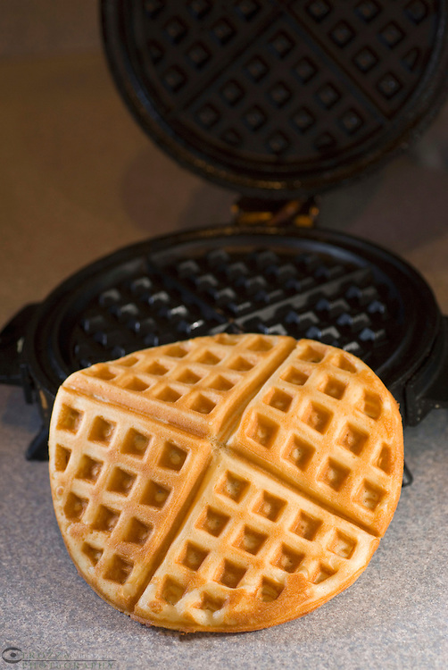 batter; waffle; iron; breakfast; food; griddle; toasted; cooking; preparing; cooked; cake; pattern; pressed; belgian; design; dough; grid; like; buttercake; indent; appliance; domestic; homemade; lattice; hot; warm; right; off; vertical