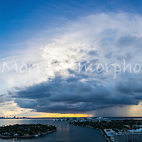 Large dramatic thunder cloud covers the city of Miami at sunset. This version is watermarked, contact us to license and clean version.