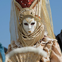 VENICE, ITALY - FEBRUARY 26:  A woman wearing a Carnival costume and mask poses near St Mark Square on February 26, 2011 in Venice, Italy.  The Venice Carnival, one of the largest and most important in Italy, attracts thousands of people from around the world each year. The  theme for this year's carnival is 'Ottocento', a nineteenth century evocation, and will run from February 19 till March 8.