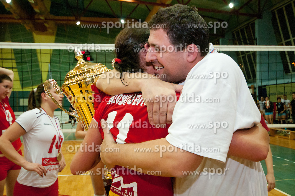 Aleksandra Milosavljevic of Nova KBM Branik Maribor huging assistant coach during volleyball match between Nova KBM Branik Maribor and Calcit Kamnik in final game of Slovenia Volleyball Cup, on Januar 4, 2012 at Sportna Dvorana, Kamnik, Slovenia. Nova KBM Branik Maribor won 3:2. (Photo By Matic Klansek Velej / Sportida)