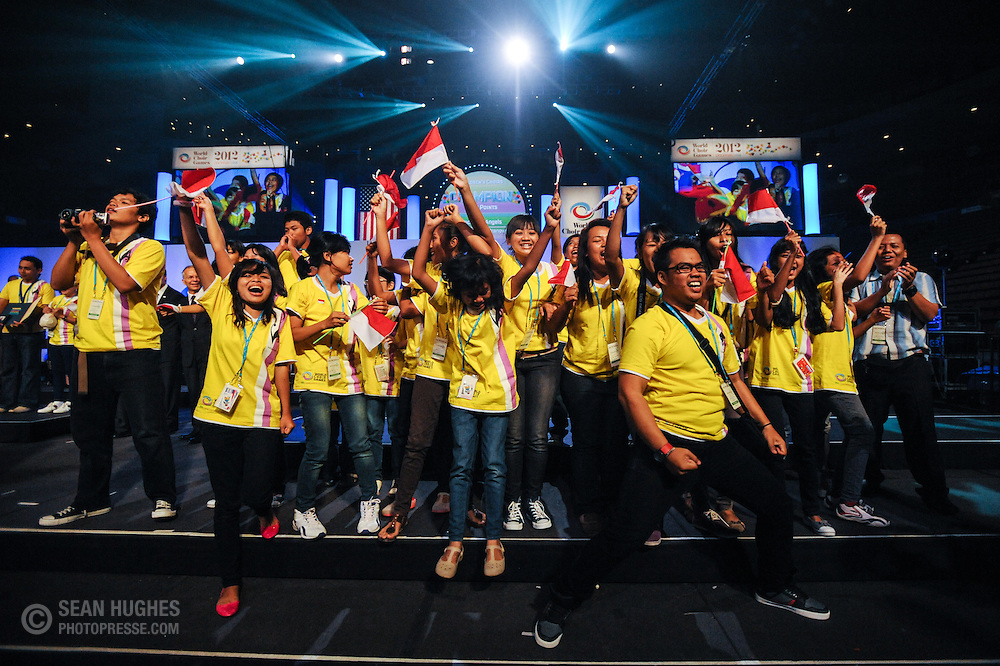 Members of the Vocalista Angels, Yason Christy Pranowo directing, Indonesia celebrate their victory in the Children's Choirs category during the final of four Award Ceremonies at the World Choir Games, July 14, 2012. (Photo: Sean Hughes)