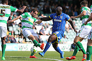 Bayo Akinfenwa of AFC Wimbledon tries to break through during the Sky Bet League 2 match between Yeovil Town and AFC Wimbledon at Huish Park, Yeovil, England on 12 September 2015. Photo by Stuart Butcher.