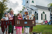 Abby Long and Marguerite Parker lead the way in their Sanbornton Congregation Church float during Sanbornton's Old Home Day parade on Saturday.  (Karen Bobotas/for the Laconia Daily Sun)