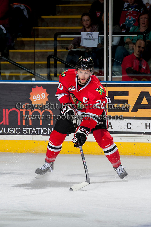 KELOWNA, CANADA - APRIL 18: Taylor Leier #20 of the Portland Winterhawks skates with the puck against the Kelowna Rockets on April 18, 2014 during Game 1 of the third round of WHL Playoffs at Prospera Place in Kelowna, British Columbia, Canada.   (Photo by Marissa Baecker/Shoot the Breeze)  *** Local Caption *** Taylor Leier;