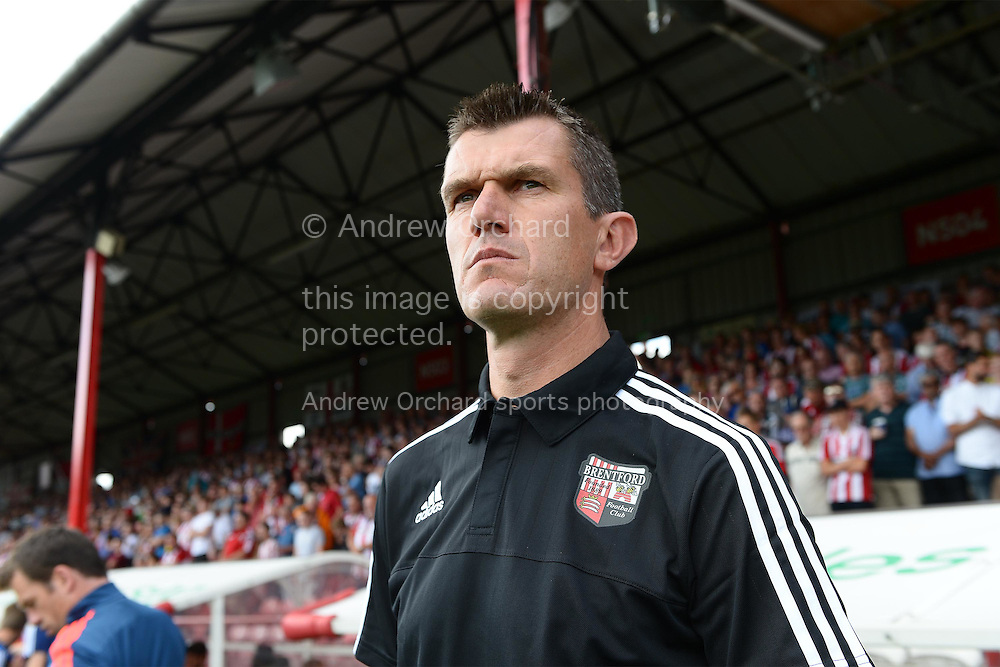 Marinus Dijkhuizen, the Brentford head coach arrives at the dugout before k/o. Skybet football league Championship match, Brentford v Ipswich Town at Griffin Park in London on Saturday 8th August 2015.<br /> pic by John Patrick Fletcher, Andrew Orchard sports photography.