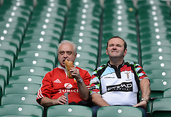 two spectators watch get there seats prior to kick off- Photo mandatory by-line: Alex James/JMP - 07966 386802 - 06/09/2014 - SPORT - RUGBY UNION - London, England - Twickenham Stadium - Saracens v Wasps - Aviva Premiership London Double Header.
