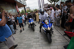 """© Licensed to London News Pictures . 12/07/2014 . Manchester , UK . A """" Free Palestine """" motorcycle convoy at Media City makes it way through crowds . Thousands of people outside the BBC at Media City in Salford , Greater Manchester , this afternoon (Saturday 12th July 2014) , protesting Israeli actions in Gaza and the Corporation's coverage of the Israeli Palestinian conflict . A convey branded """" Drive for Justice """" travelled from out of the city from Bradford , Blackburn and other regions , to form the protest . Photo credit : Joel Goodman/LNP"""