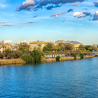 Guadalquivir river east bank from the Triana bridge, with the Giralda tower (left) and Golden Tower (right) among other landmarks. Seville, Spain.