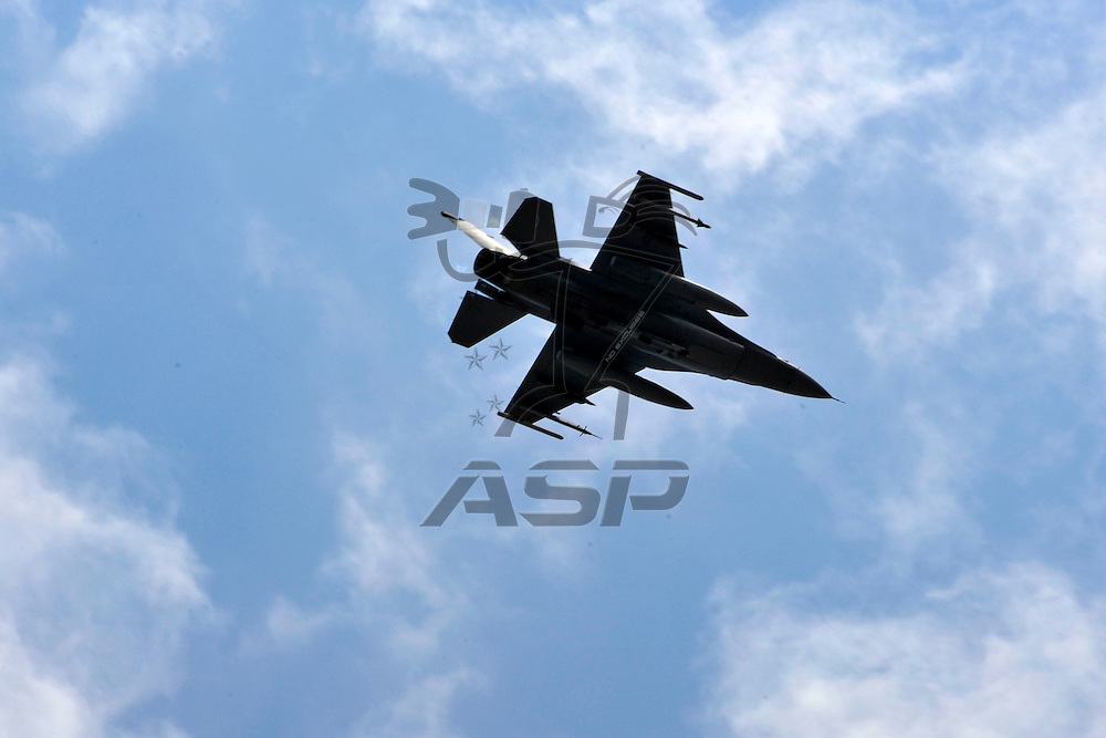 Brooklyn, MI - JUN 17, 2012: Military jets perform the fly over before race action for the Quicken Loans 400 race at the Michigan International Speedway in Brooklyn, MI.