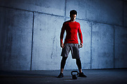 Athlete standing before kettlebell workout