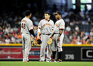 Apr. 17 2011; Phoenix, AZ, USA; San Francisco Giants third basemen Pablo Sandoval (48) , second basemen .Freddy Sanchez (21) and shortstop Miguel Tejada (10) talk on the field while playing against the Arizona Diamondbacks at Chase Field. The Diamondbacks defeated the Giants 6-5 in extra innings. Mandatory Credit: Jennifer Stewart-US PRESSWIRE..