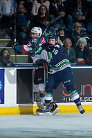 KELOWNA, CANADA - APRIL 25: Donovan Neuls #19 of the Seattle Thunderbirds checks Rodney Southam #17 of the Kelowna Rockets into the boards on April 25, 2017 at Prospera Place in Kelowna, British Columbia, Canada.  (Photo by Marissa Baecker/Shoot the Breeze)  *** Local Caption ***