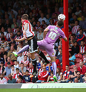 (Carlos) Orlando Sa (Reading striker) holding off Maxim Colin (Brentford defender) to set up another Reading attack during the Sky Bet Championship match between Brentford and Reading at Griffin Park, London, England on 29 August 2015. Photo by Matthew Redman.