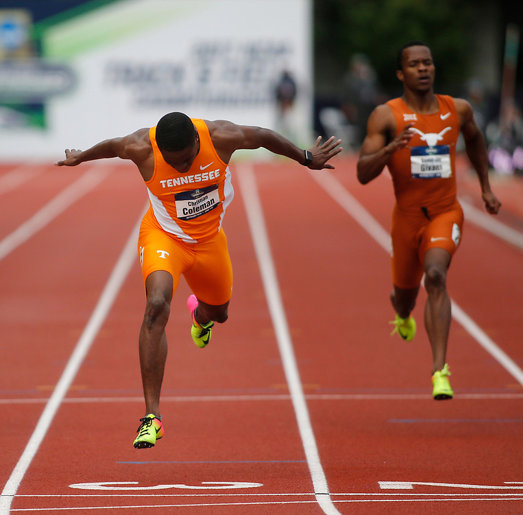 Tennessee's Christian Coleman crosses the finish line ahead of Texas' Senoj-Jay Givans, right, to win the men's 200 meters in the time of 20.25 seconds on the third day of the NCAA outdoor college track and field championships in Eugene, Ore., Friday, June 9, 2017. (AP Photo/Timothy J. Gonzalez)
