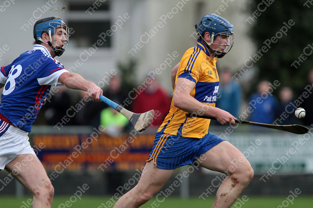 Clare's Daire Keane heads for goal and being chased down by WIT's Luke O'Loughlin in the Waterford Crystal Hurling Tournament @ Sixmilebridge. - Photograph by Flann Howard