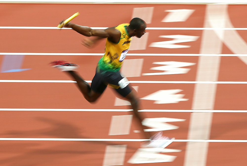 epa03358312 Usain Bolt of Jamaica on the finish line to win men's 4x100m final at the London 2012 Olympic Games Athletics, Track and Field events at the Olympic Stadium, London, Britain, 11 August 2012.  EPA/NIC BOTHMA