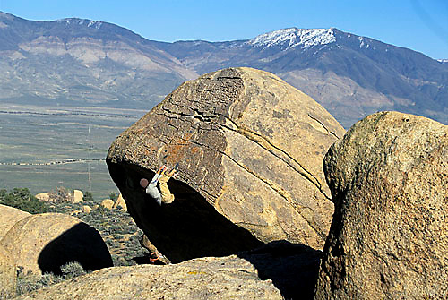 Chris Muzzillo bouldering at the Druid Stones; Bishop, CA.<br />