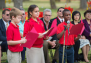 Fourth grade students introduce guests during a groundbreaking ceremony for the new Mandarin Chinese Language Immersion Magnet School, December 6, 2014.