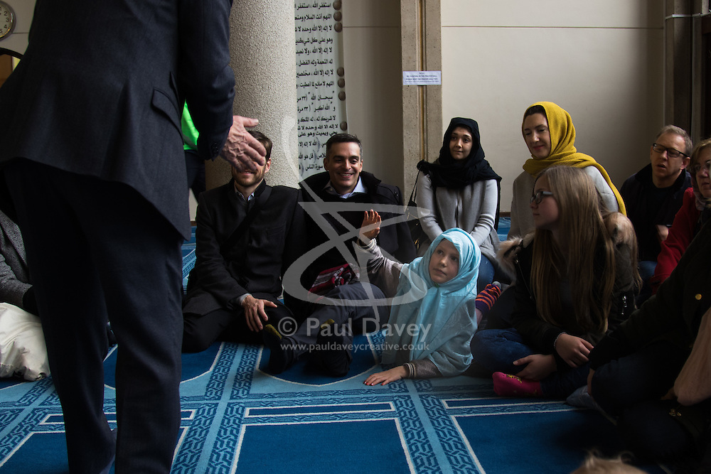 Regents Park Mosque, London, February 5th 2017. Dozens of curious non-Muslims are welcomed at Regent's Park Mosque in London as part of the Muslim Council of Britain's annual 'Visit My Mosque Day'. Visitors were able to observe prayers and we shown around the mosque by members, where there was a exhibition of the history and teachings of Islam. PICTURED: A young girl  asks why Muslim women wear a head covering.