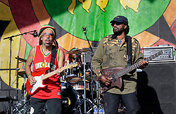 "30 April 2015. New Orleans, Louisiana.<br /> The New Orleans Jazz and Heritage Festival. <br /> Stephen 'Cat' Coore (l) and Richie ""Bassie"" Daley of legendary Reggae band Third World playing the Congo Square stage.<br /> Photo; Charlie Varley/varleypix.com"