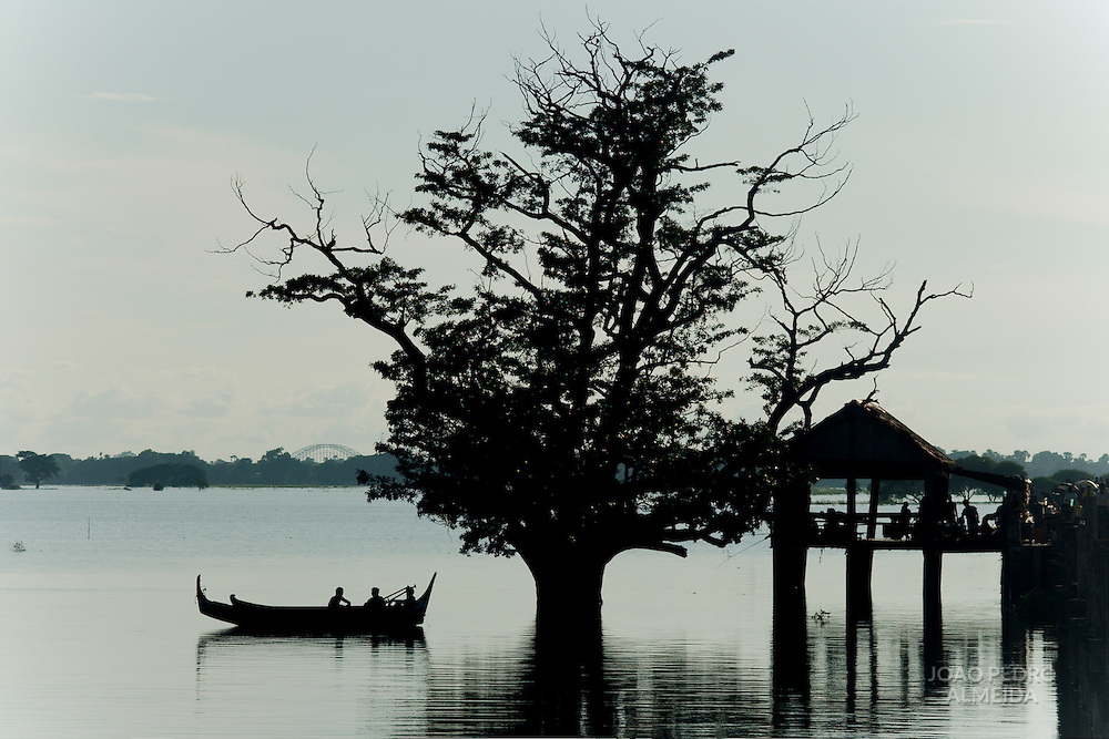 fishermen on rowboat near U Bein bridge at Amarapura