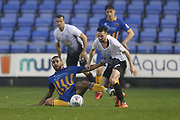 45 Stefan Payne for Shrewsbury Town and 7 Gwion Edwards for Peterborough United during the EFL Sky Bet League 1 match between Shrewsbury Town and Peterborough United at Greenhous Meadow, Shrewsbury, England on 24 April 2018. Picture by Graham Holt.